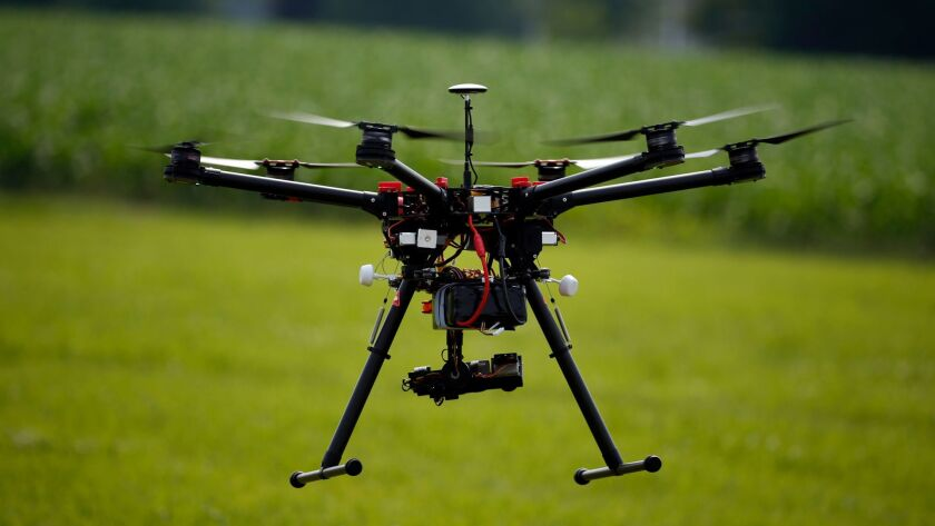 FILE - In this June 11, 2015, file photo, a hexacopter drone is flown during a drone demonstration i