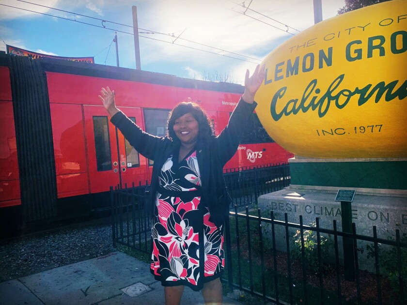 Lemon Grove Mayor Racquel Vasquez in front of the city's iconic lemon.