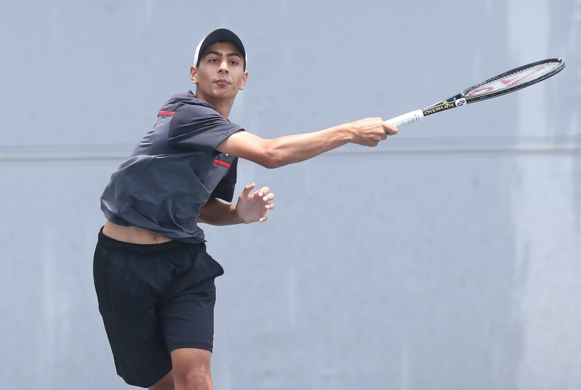 Lawee Sherif of Huntington Beach rips a forehand winner as he approaches the net against Andy Hernandez of Fullerton in the boys' 16-and-under quarterfinals of the USTA Southern California Junior Sectional Championships at Los Caballeros Sports Village on Friday.