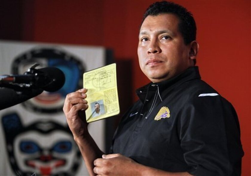 Percy Abrams, Iroquois Nationals lacrosse team board of directors executive directors, shows his Haudenosaunee, or Iroquois Confederacy, passport during a news conference in New York, Wednesday, July 14, 2010. The U.S. government on Wednesday agreed to let the Native American lacrosse team travel t
