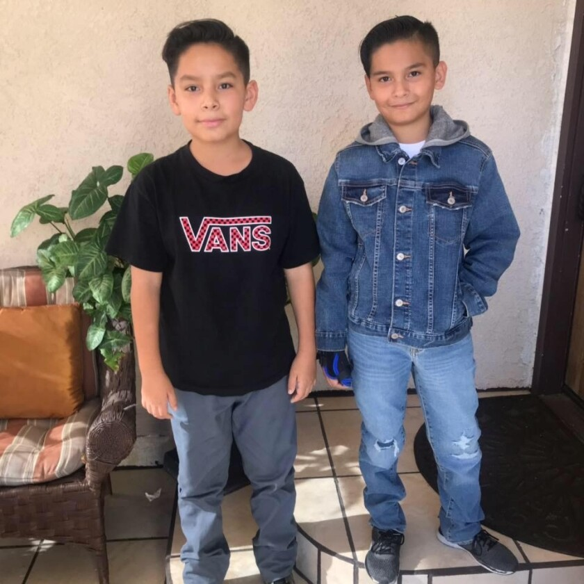 Adrian Lemus, left, and Israel Lemus, shown in this recent family photo, were killed Nov. 1 when their mother's car slammed into the back of a tractor-trailer parked on the shoulder of southbound Interstate 15 near Miramar Road. The two were students at the Language Academy in San Diego.