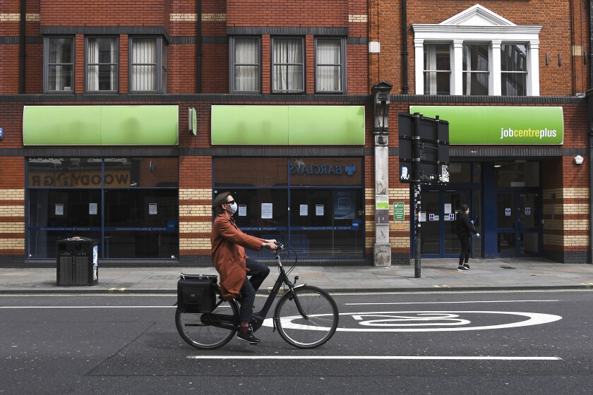 Woman passes a job-search center in London