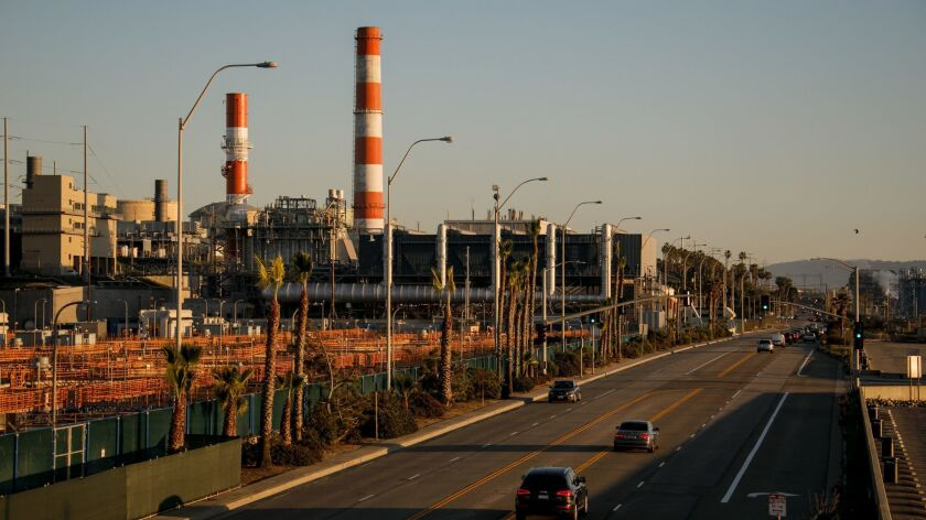 Los Angeles is abandoning a plan to spend billions of dollars rebuilding three gas-fired power plants along the coast to get the city closer to its goal of 100% renewable energy and improve air quality. Seen here is the Scattergood plant in El Segundo on Feb. 11.