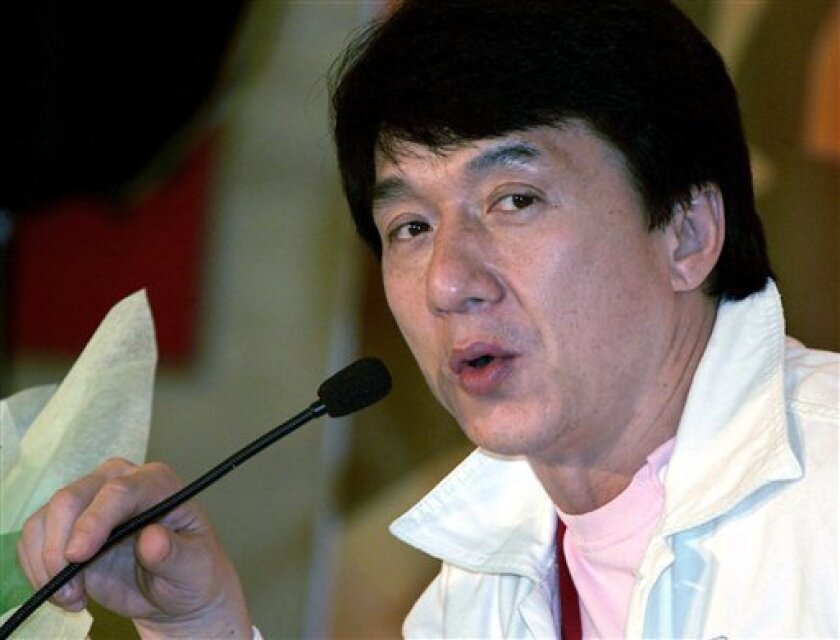 """In this Sept. 1, 2005 file photo, Jackie Chan speaks during a news conference in Shanghai, China. Chan is in talks with Columbia Pictures to star in a remake of """"The Karate Kid,"""" a spokesman for the Hollywood studio said Thursday, Jan. 15, 2009. (AP Photo/Eugene Hoshiko, File)"""