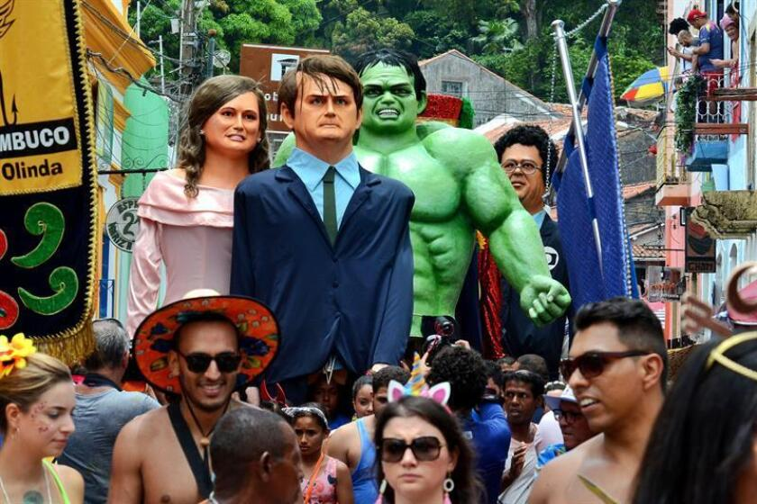 Towering figures of Brazil's far-right President Jair Bolsonaro (c.), first lady Michelle Bolsonaro (c.l.), and the Incredible Hulk (c.r.) are among the many giant puppets in the traditional Carnival parade in Olinda, Pernambuco state, on March 4, 2019. EFE-EPA/Ney Douglas