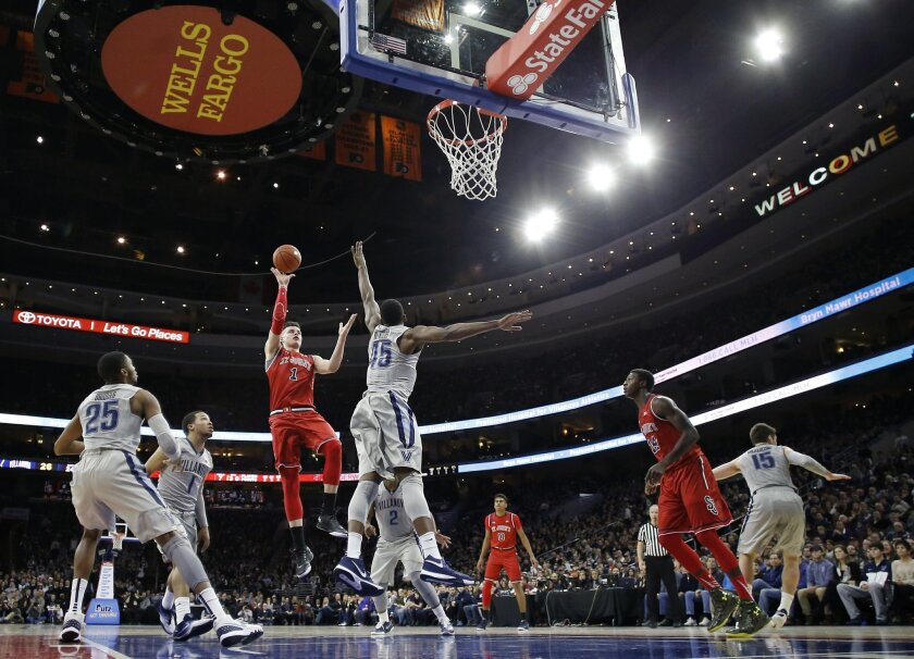 St. John's Amar Alibegovic (1) goes up for a shot against Villanova's Darryl Reynolds (45) during the first half of an NCAA college basketball game, Saturday, Feb. 13, 2016, in Philadelphia. (AP Photo/Matt Slocum)