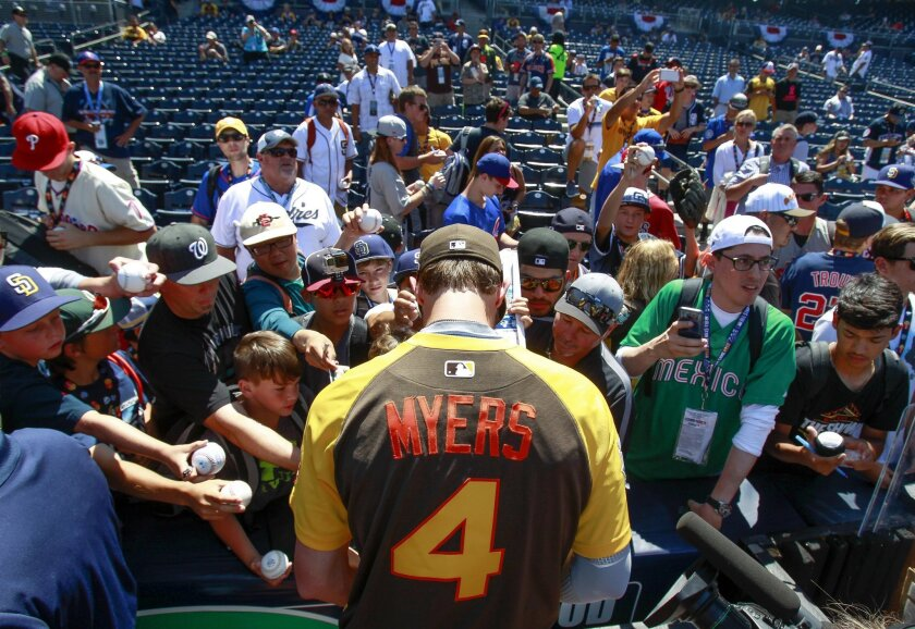 The Padres' Wil Myers signs autographs for fans before the start of the All-Star Game.