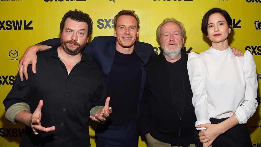 """Danny McBride, from left, Michael Fassbender, Ridley Scott, and Katherine Waterston at the """"Alien"""" premiere at the South by Southwest festival on March 10, 2017, in Austin, Texas."""