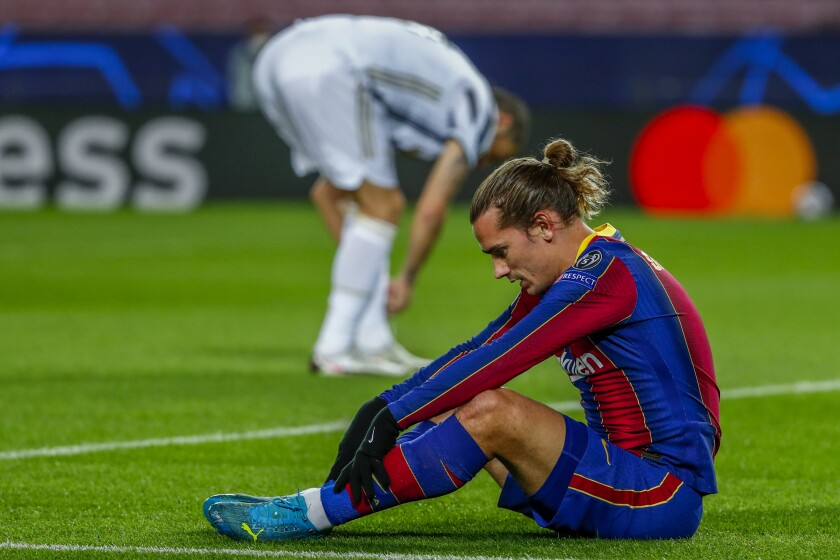 Barcelona's Antoine Griezmann reacts after missing a chance during the Champions League group G soccer match between FC Barcelona and Juventus at the Camp Nou stadium in Barcelona, Spain, Tuesday, Dec. 8, 2020. (AP Photo/Joan Monfort)