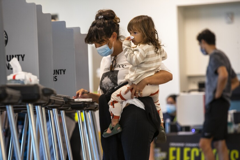 Ashley Montague votes at Marina Park Community Center in Newport Beach on election day.