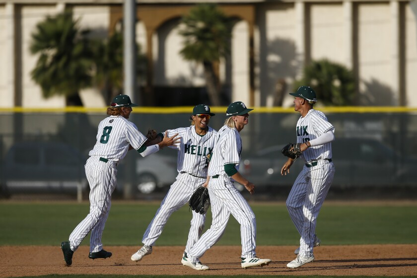 Helix players celebrate their shutout win over Granite Hills on Friday.