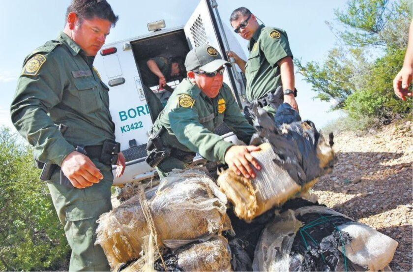 Border Patrol agents in 2007 with marijuana seized from drug smugglers in Laredo, Texas. (John Moore / Getty Images)
