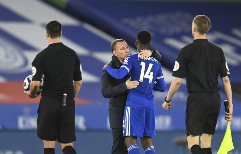 Leicester's manager Brendan Rodgers, second left, celebrates with Leicester's Kelechi Iheanacho at the end of the English Premier League soccer match between Leicester City and West Bromwich Albion at the King Power Stadium in Leicester, England, Thursday, April 22, 2021. (Michael Regan/Pool via AP)