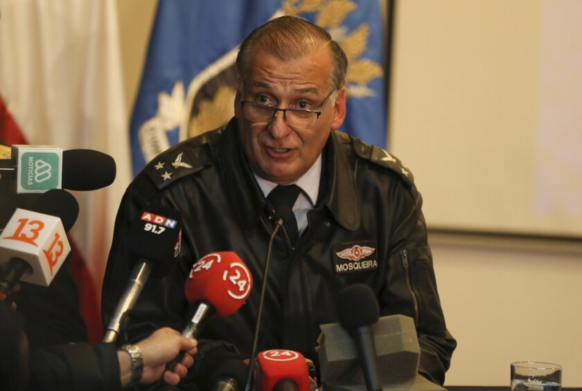 Air Force Gen. Eduardo Mosqueira speaks during a news conference at his headquarters in Punta Arenas, Chile, Wednesday, Dec. 11, 2019. Chilean officials say they've found debris believed to be from a transport plane that vanished en route to Antarctica. (AP Photo/Fernando Llano)