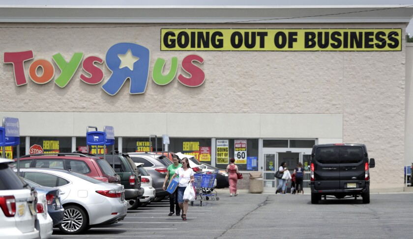 FILE - In this Friday, June 1, 2018 file photo, customers walk back to their vehicles after shopping