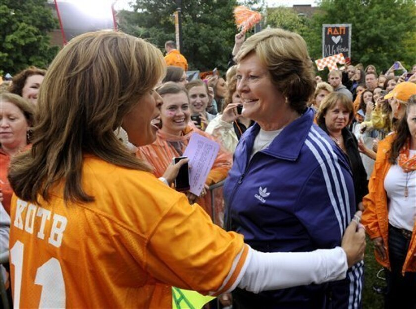 """Hoda Kotb, left, the co-host of the fourth hour of NBC's """"Today"""" show, greets Lady Vol coach emeritus Pat Summitt during a broadcast from the University of Tennessee Monday, Oct. 1, 2012, in Knoxville, Tenn. UT won an online contest sponsored by """"Today"""" to bring Kotb and co-host Kathie Lee Gifford to town with their show. (AP Photo/Knoxville News Sentinel, Michael Patrick)"""