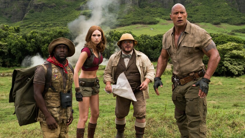 "Kevin Hart, left, Karen Gillan, Jack Black and Dwayne Johnson in the movie ""Jumanji: Welcome to the Jungle."""