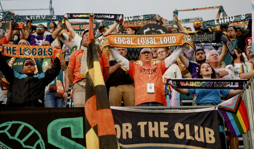 Fans in the standsshow their support for the San Diego Loyal soccer team