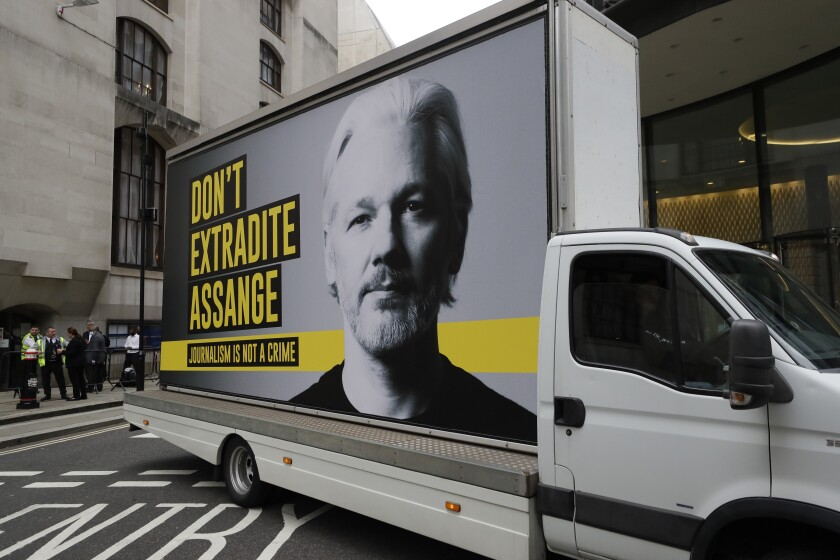 A billboard truck depicting Julian Assange drives past the Central Criminal Court Old Bailey in London, Tuesday, Sept. 8, 2020. Lawyers for WikiLeaks founder Julian Assange and the U.S. government were squaring off in a London court on Monday at a high-stakes extradition case delayed by the coronavirus pandemic. American prosecutors have indicted the 49-year-old Australian on 18 espionage and computer misuse charges over Wikileaks' publication of secret U.S. military documents a decade ago. The charges carry a maximum sentence of 175 years in prison. (AP Photo/Kirsty Wigglesworth)