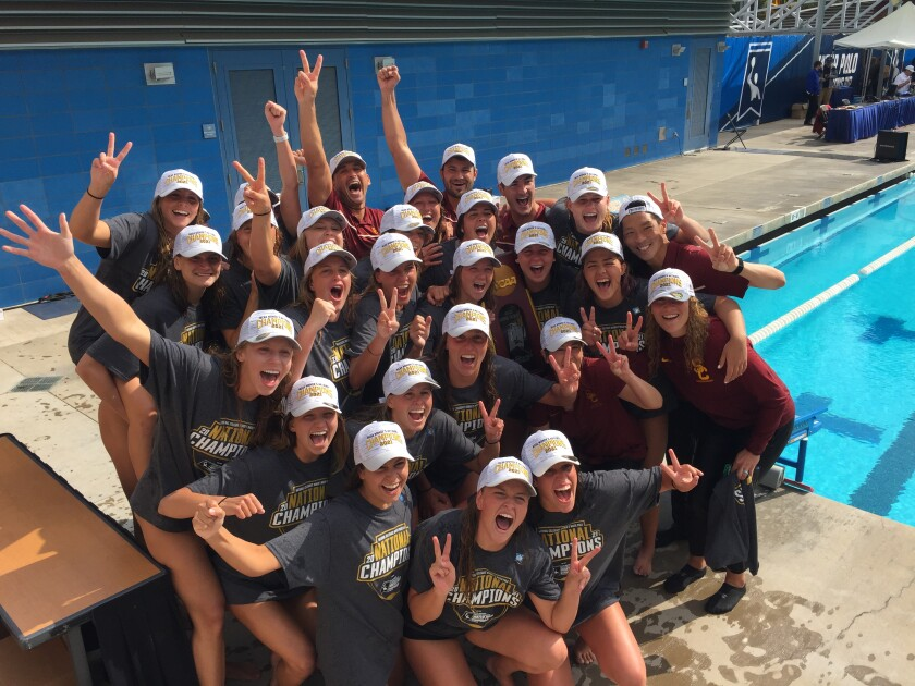 The USC's women's water polo team celebrates after defeating UCLA to win the 2021 NCAA water polo title.