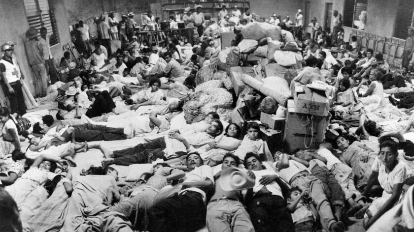 Salvadoran refugees working in Honduras are housed at Red Cross headquarters in San Miguel on July 7, 1969, following the start of the Football War.