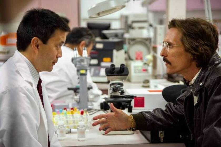 "Joji Yoshida as Dr. Hiroshi and Matthew McConaughey as Ron Woodroof in ""Dallas Buyers Club."""