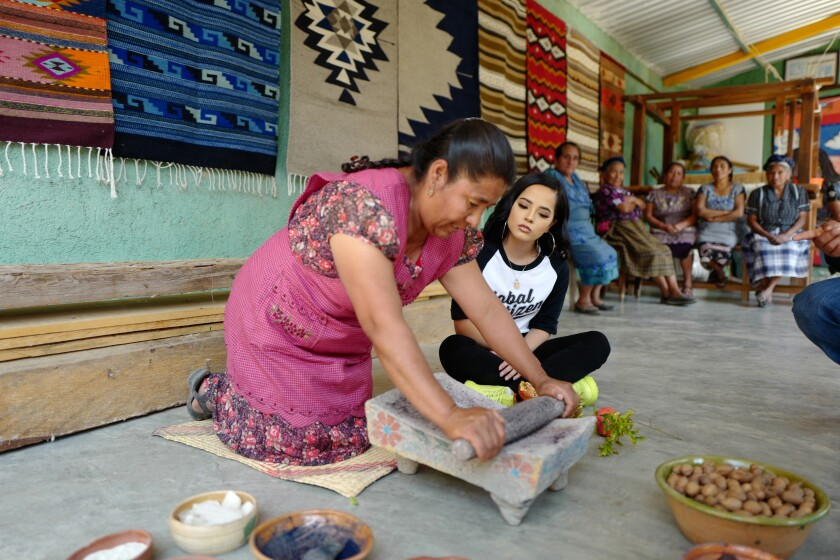 """Becky G watches and learns dye making in Mexico, on National Geographic's """"Activate: The Global Citizen Movement."""""""