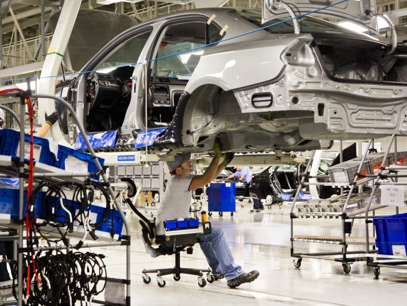 An employee works on a Passat sedan at the Volkswagen plant in Chattanooga, Tenn. Workers at the plant voted against representation by the United Auto Workers union.