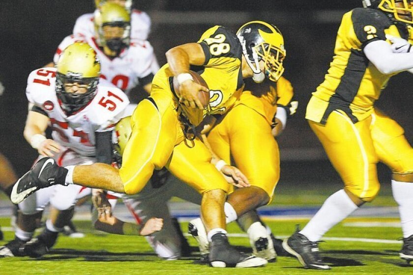 Mission Bay senior quarterback Dillon Baxter, who set two state scoring records, leads the Bucs offense in a 58-42 Division IV semifinal win over Santa Fe Christian. Baxter, who will attend USC, rushed for 185 yards and passed for 270 yards as Mission Bay piled up 536 yards on offense.