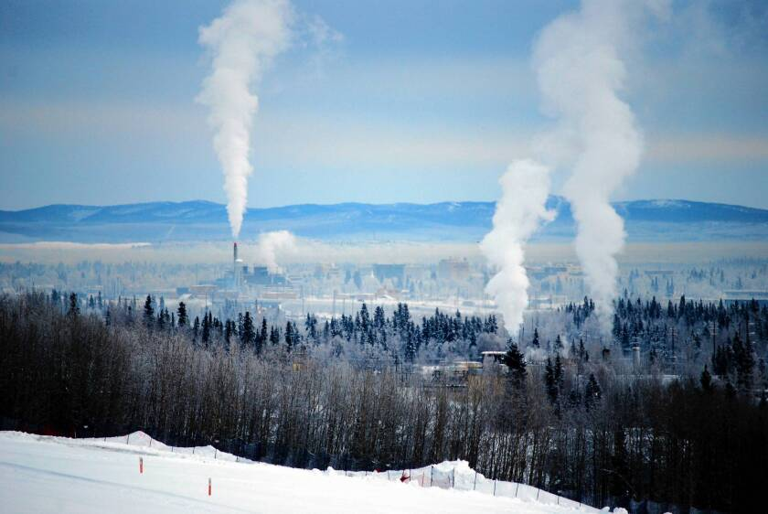 Fairbanks area, trying to stay warm, chokes on wood stove pollution
