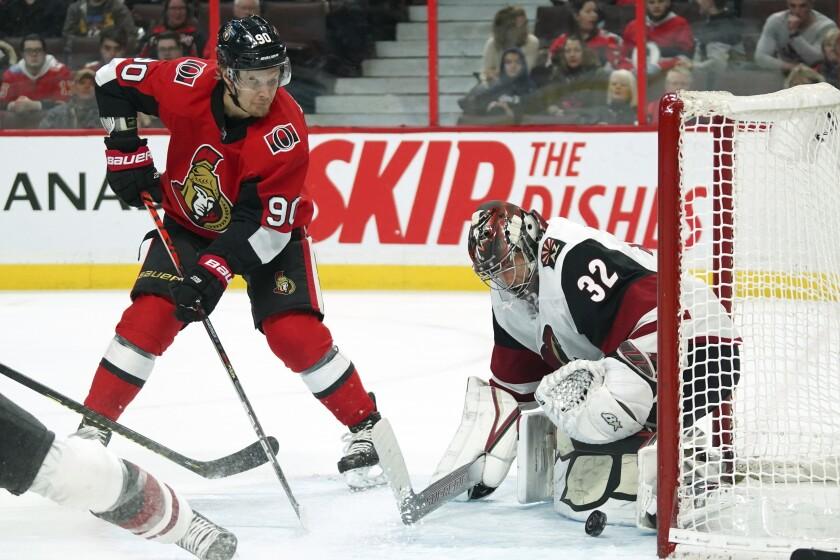 Ottawa Senators left wing Vladislav Namestnikov (90) shoots against Arizona Coyotes goaltender Antti Raanta (32) during second-period NHL hockey game action in Ottawa, Ontario, Thursday, Feb. 13, 2020. (Chris Wattie/The Canadian Press via AP)