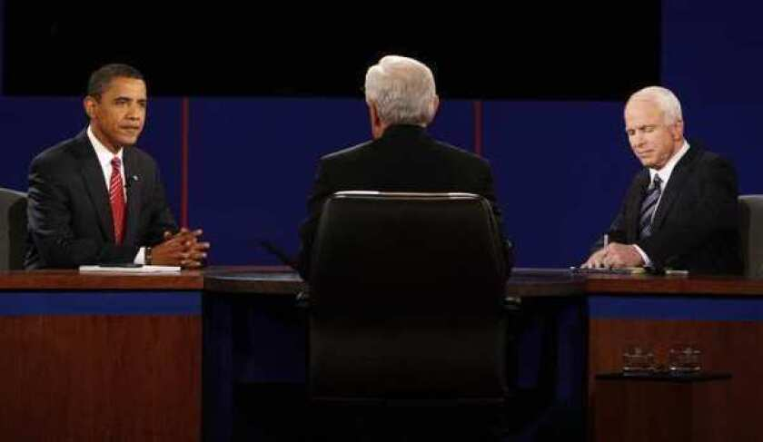 In 2008, then-Democratic presidential candidate Barack Obama and Republican presidential candidate John McCain exchange responses as debate moderator Bob Schieffer listens during a presidential debate.