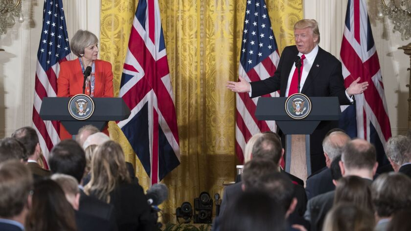 """British Prime Minister Theresa May and President Trump address the media during her visit to Washington, D.C., last year. Trump has canceled a visit to Britain saying he was not a """"big fan"""" of the new U.S. embassy in London."""
