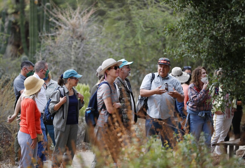 Michael Miskwish, right, of the Campo Kumeyaay Nation, speaks to a group at the San Diego Zoo Safari Park.