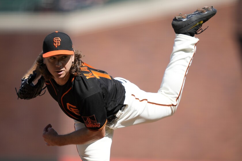 Giants left-hander Scott Kazmir delivers against the Dodgers during the first inning May 22, 2021.