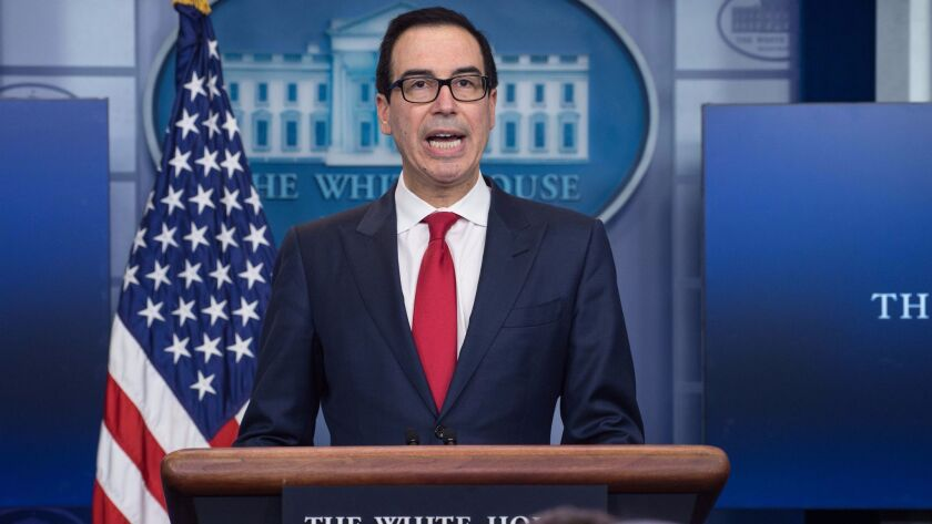 Treasury Secretary Steven T. Mnuchin speaks during a news briefing at the White House on Thursday.