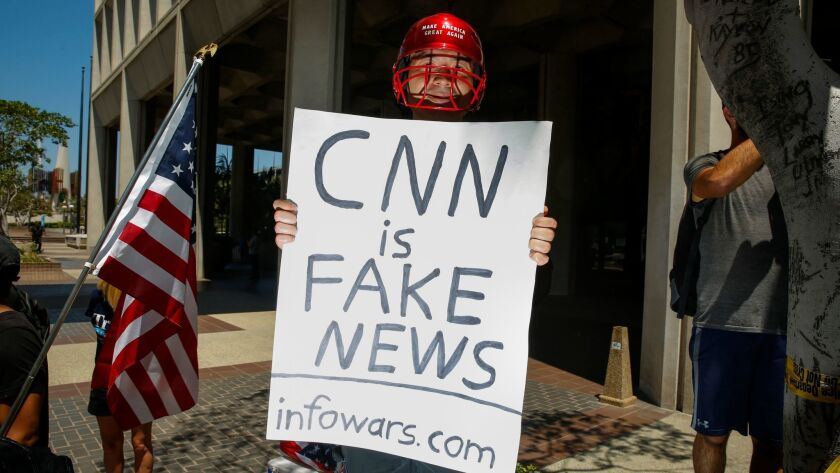 "LOS ANGELES,CA --SUNDAY, JULY 02, 2017--A man holding a sign that says, ""CNN is Fake News"" and ""info"