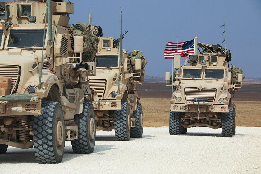 An American military convoy stops near the town of Tel Tamr, Syria.