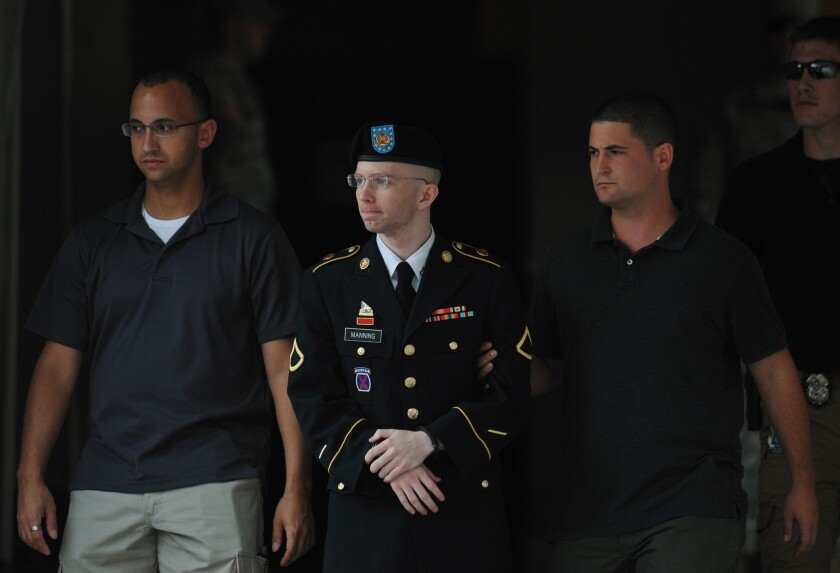 Army Pfc. Bradley Manning is escorted from court last week in Fort Meade, Md.