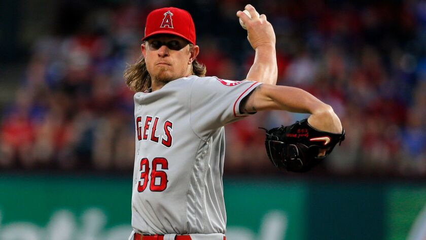 Los Angeles Angels starting pitcher Jered Weaver throws to the Texas Rangers in the first inning of a baseball game, Wednesday, Sept. 21, 2016, in Arlington, Texas.