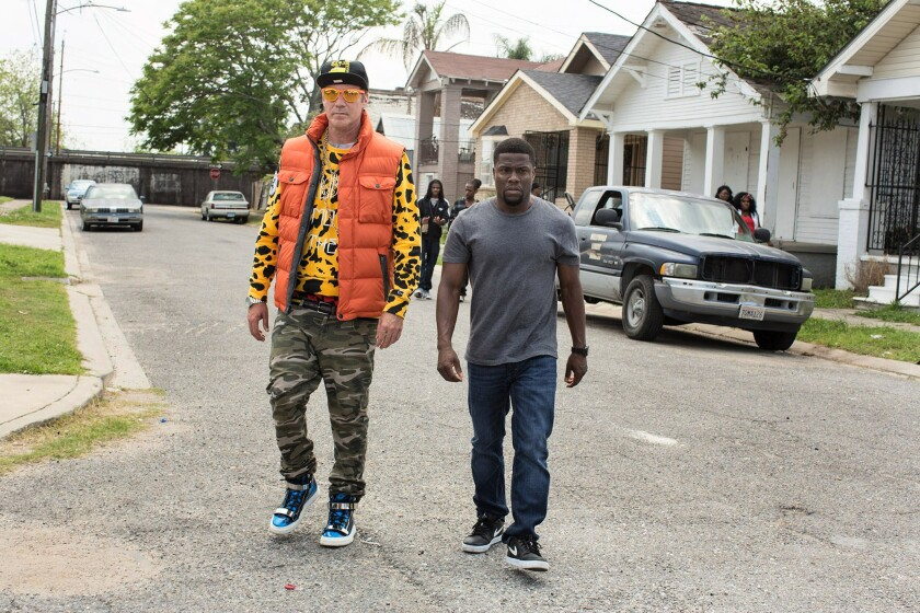 "In ""Get Hard,"" Will Ferrell's hedge-fund manager, left, tries out a new look under the tutelage of Kevin Hart's car wash employee."