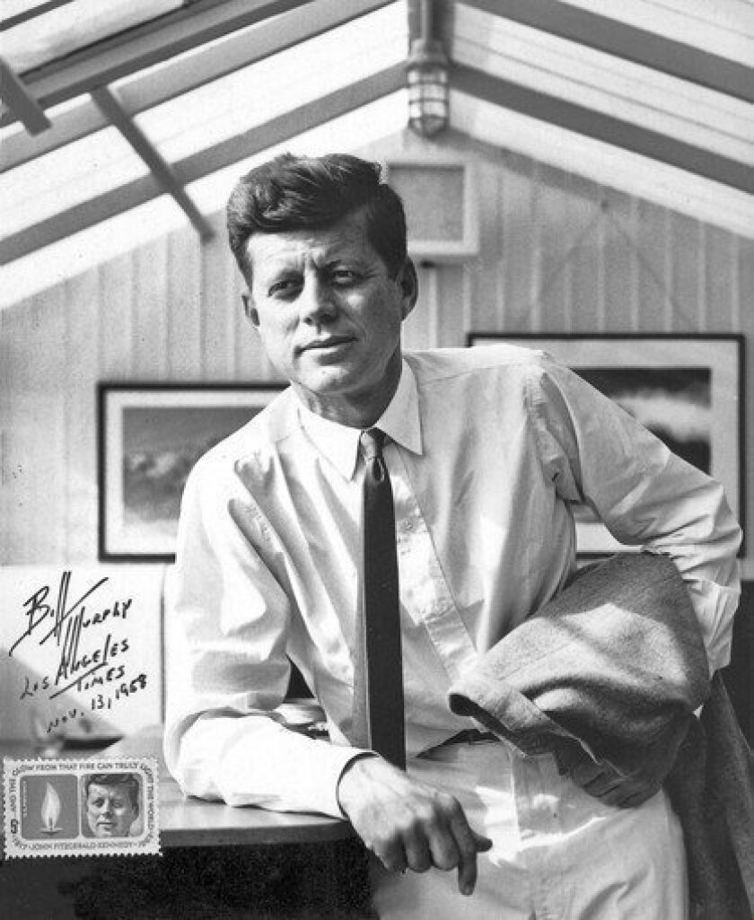 This portrait of then-Sen. John F. Kennedy was taken in 1958 at his sister's Santa Monica home and was later used in 1964 in the first stamp commemorating him after his assassination. William S. Murphy, who took the photo, autographed the print and placed one of the stamps in the lower left corner.