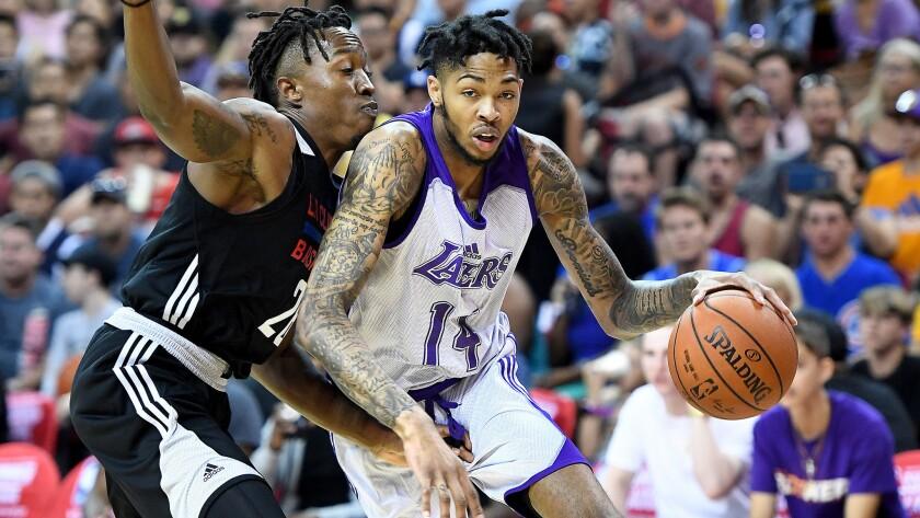 LAS VEGAS, NEVADA JULY 7, 2017-Lakers Brandon Ingram drives on Clippers Jaron Johnson during the NBA