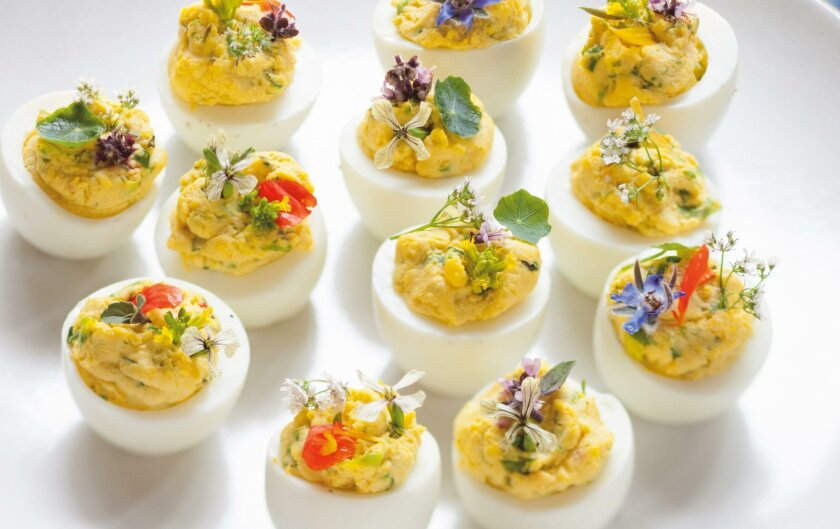 """Deviled Eggs With Goat Cheese from """"The Portable Feast"""" by Jeanne Kelley."""