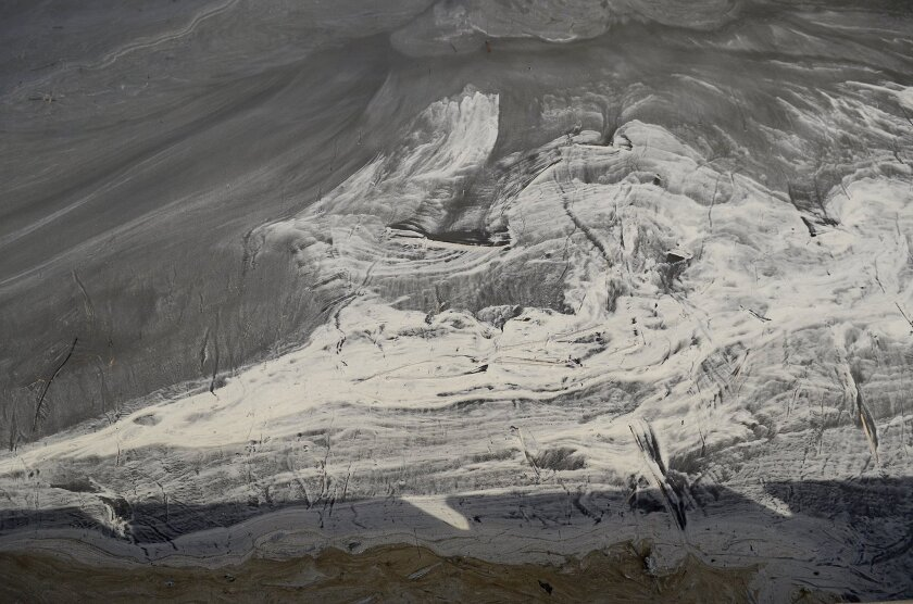 Days after the initial spill, swirls of coal ash accumulated in eddies in the now-gray Dan River, downstream from Eden, N.C.