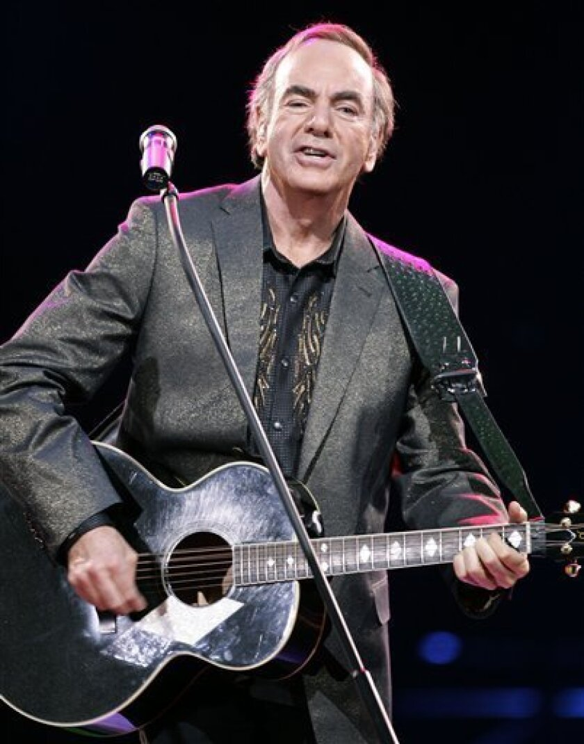 In this May 27, 2008 file photo, U.S. singer Neil Diamond performs during his concert in Munich, southern Germany. (AP Photo/Christof Stache, file)