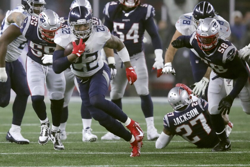 Tennessee Titans running back Derrick Henry runs from New England Patriots defenders in the first half of an NFL wild-card playoff football game, Saturday, Jan. 4, 2020, in Foxborough, Mass. (AP Photo/Charles Krupa)