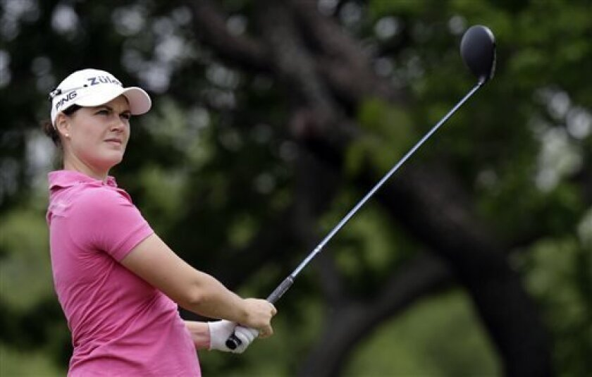 Caroline Masson, of Germany, watches her tee shot on the first hole during the second round of the North Texas LPGA Shootout golf tournament on Friday, April 26, 2013, at Los Colinas Country Club in Irving, Texas. (AP Photo/LM Otero)