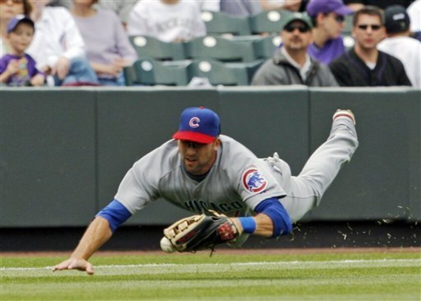 Chicgo Cubs leftfielder Mark DeRosa dives and misses the ball off the bat of Colorado Rockies hitter Scott Podsednik in the second inning of a Major League Baseball game in Denver on Thursday, April 24, 2008. (AP Photo/David Zalubowski)