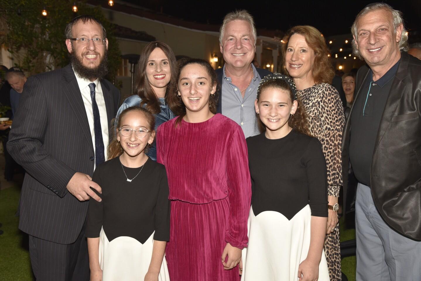 Rabbi Levi and Devorah Raskin with Chaya, Dena, and Mussi, Mark and Elizabeth Greenhill, Michael Greenhill